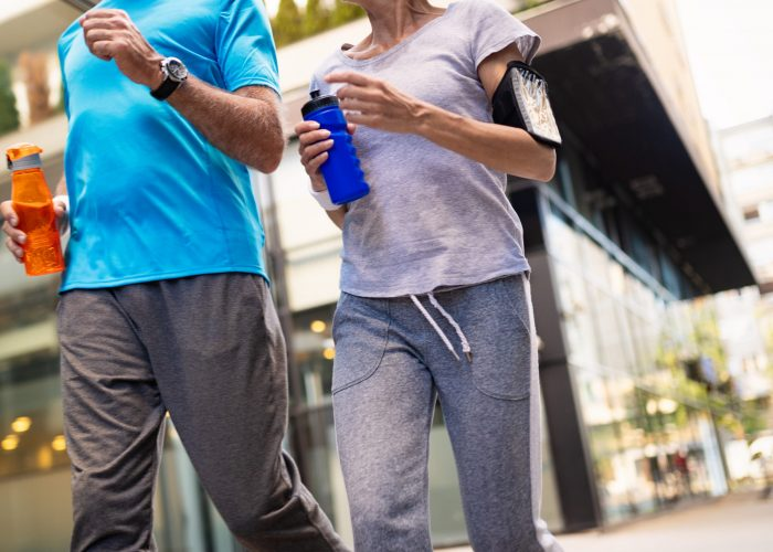 Fitness, sport, people, exercising and lifestyle concept - mature couple running